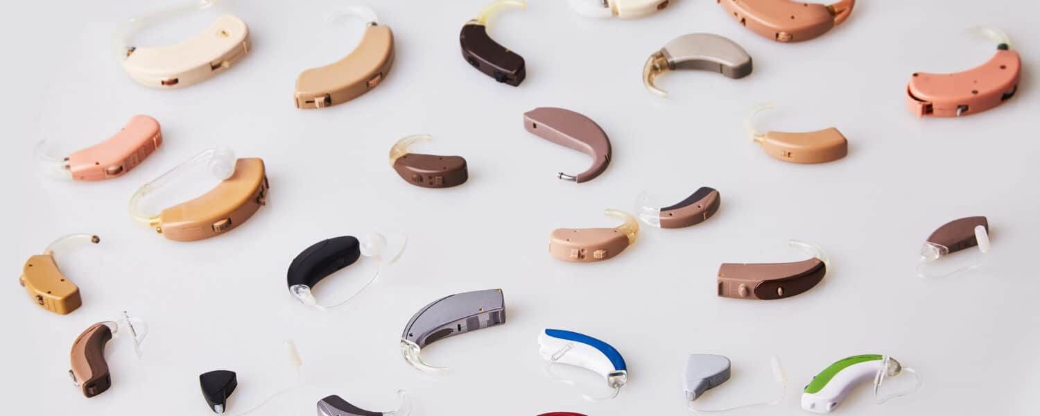 Various hearing aids on white background, displaying high quality hearing aids at a different hearing aid cost.