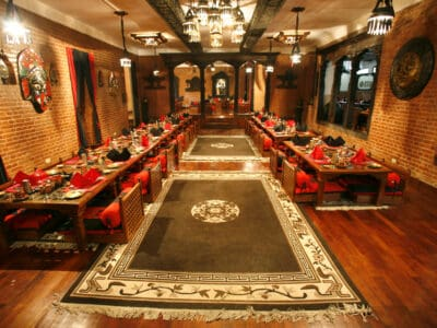 Carpeting and curtains in a restaurant can improve the acoustics of a room and assist people wearing a premium hearing aid.