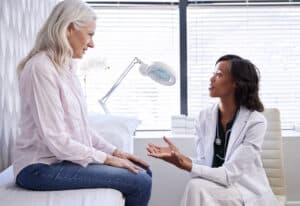Mature woman in a consultation with a hearing aid to check her hearing to see if she needs a premium hearing aid