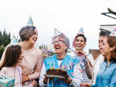 Generations women Family Celebrating a happy Birthday in Latin America, some with age related hearing loss