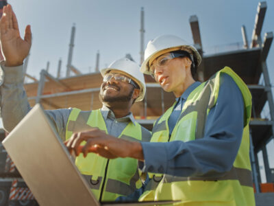 Man and woman at a construction site. If they don't wear ear protection they may experience noise-induced hearing loss