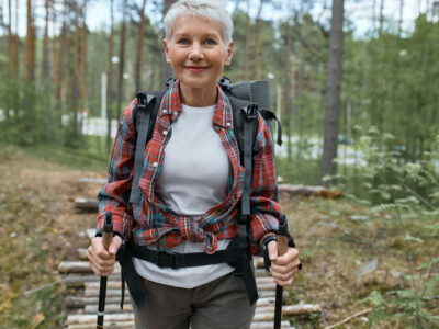 elderly woman hiking, showing that there is a way to go out with hearing aids