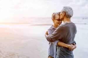 Man and woman at the beach. support someone with hearing loss