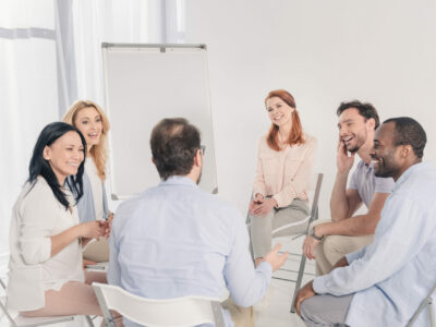 Group of people discussing programmable hearing aids