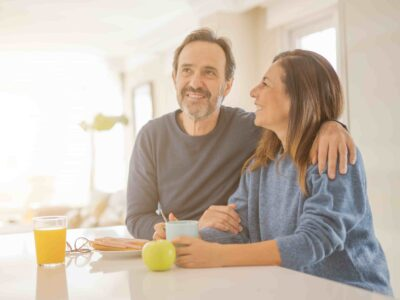 healthy couple in the kitchen discussing mdhearingaid